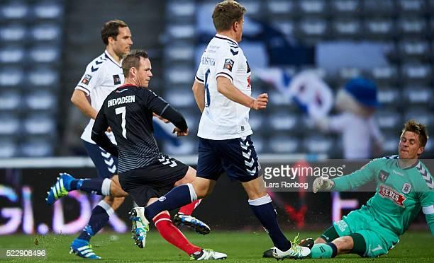Thomas Enevoldsen of AaB Aalborg scores the 10 goal against Goalkeeper Steffen Rasmussen of AGF Aarhus during the Danish Cup DBU Pokalen semifinal...