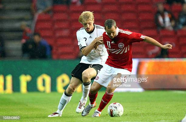 Thomas Enevoldsen of Denmark and Andreas Beck of Germany compete for the ball during the International Friendly match between Denmark and Germany at...