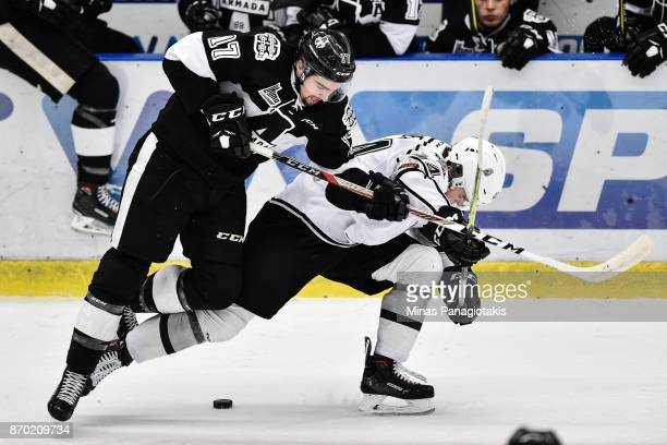 Thomas Ethier of the BlainvilleBoisbriand Armada and Gabriel Bilodeau of the Gatineau Olympiques battle for the puck during the QMJHL game at Centre...