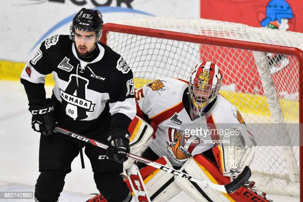 Thomas Ethier of the BlainvilleBoisbriand Armada screens goaltender Antoine Samuel of the BaieComeau Drakkar during the QMJHL game at Centre...