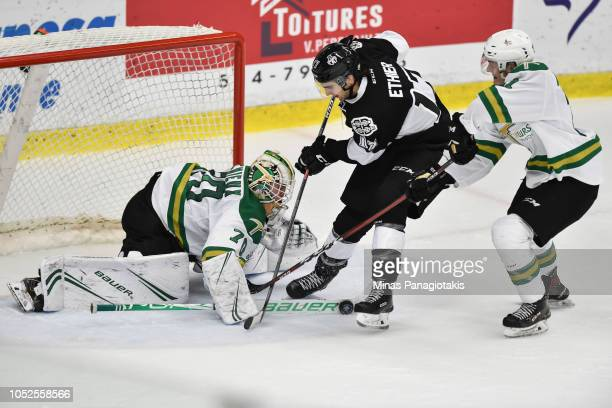 Thomas Ethier of the BlainvilleBoisbriand Armada skates past Maxence Guenette and is stopped by goaltender Jonathan Lemieux of the ValdOr Foreurs...
