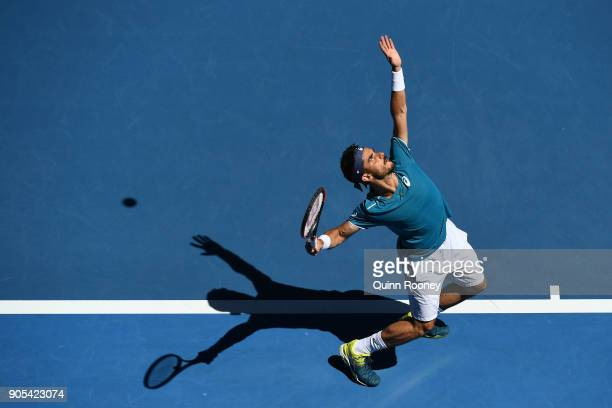 Thomas Fabbiano of Italy serves in his first round match against Alexander Zverev of Germany on day two of the 2018 Australian Open at Melbourne Park...