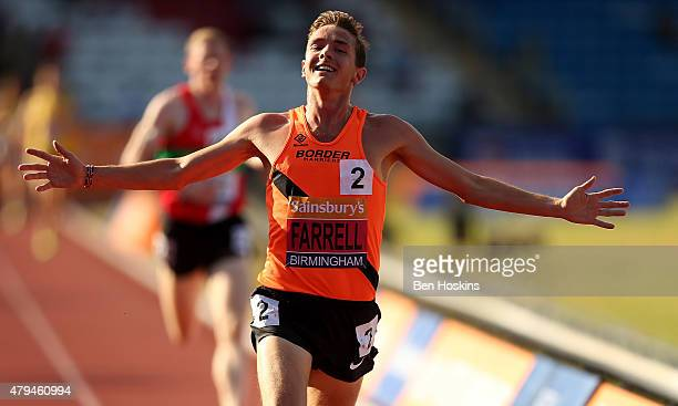 Thomas Farrell of Great Britain celebrates as he wins the mens 5000m final on day two of the Sainsbury's British Championships at Birmingham...