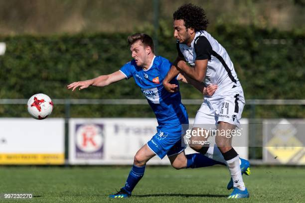 Thomas Foket of KAA Gent Amr Warda of Paok Saloniki during the friendly match between PAOK Saloniki and KAA Gent at sportcomplex Schuytgraaf on July...
