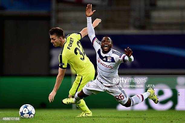 Thomas Foket of KAA Gent takes down Aldo Kalulu of Olympique Lyonnais during the UEFA Champions League Group H match between KAA Gent and Olympique...