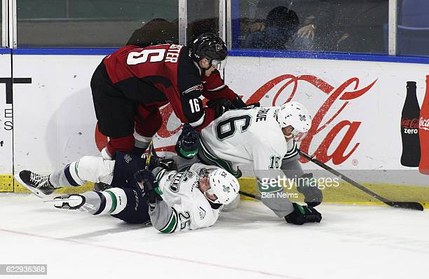 Thomas Foster of the Vancouver Giants checks Alexander True and Ethan Bear of the Seattle Thunderbirds during the third period of their WHL game at...