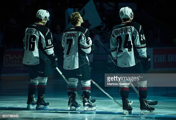 Thomas Foster Ty Ronning and Matt Barberis of the Vancouver Giants line up against the Kelowna Rockets on November 18 2016 at Prospera Place in...