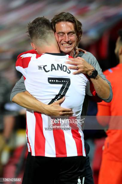 Thomas Frank , head coach of Brentford celebrate with team mate Sergi Canós after the Sky Bet Championship Play Off Semi-final 2nd Leg match between...