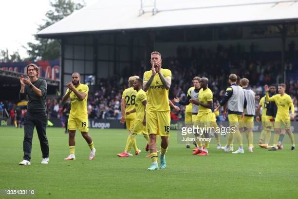 Thomas Frank, Manager of Brentford, Bryan Mbeumo and Pontus Jansson of Brentford applaud the fans after the Premier League match between Crystal...