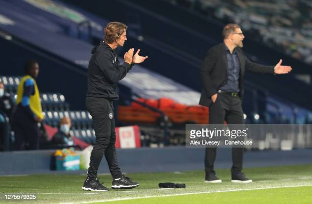 Thomas Frank the manager of Brentford and Slaven Bilic the manager of West Bromwich Albion look on during the Carabao Cup third round match between...