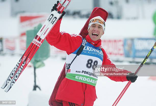 Thomas Frei of Switzerland celebrates after taking the third place in the Men's 10km Sprint in the e.on Ruhrgas IBU Biathlon World Cup on December...