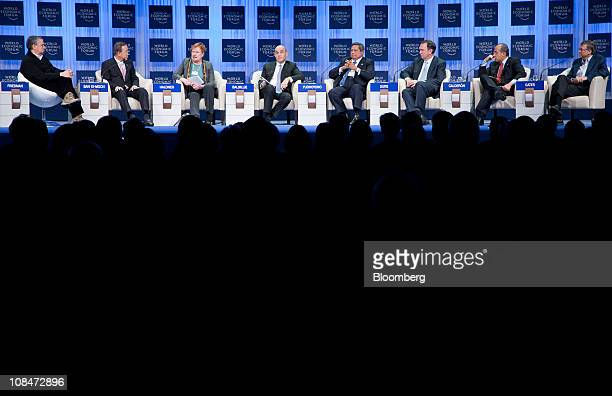 Thomas Friedman a columnist with the New York Times left moderates a discussion between panelists from second left Ban Kimoon secretarygeneral of the...