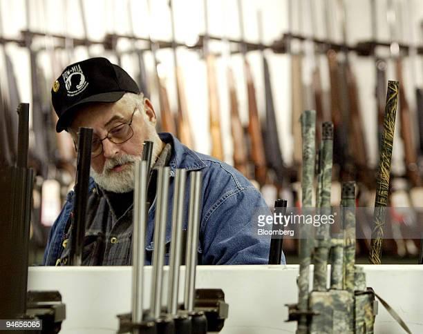 Thomas Gantt of Columbus shops for a rifle at Vance's gun store in Columbus Ohio on Thursday April 5 2007 Remington Arms Co the gunmaker that has...