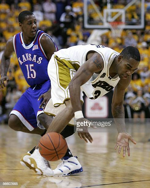 Thomas Gardner of the Missouri Tigers loses control of the ball as Mario Chalmers of Kansas Jayhawks defends on January 16 2006 at Mizzou Arena in...