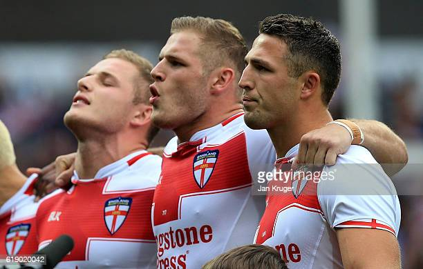 Thomas George and Sam Burgess of England sing the national anthem during the Four Nations match between England and New Zealand Kiwis at John Smith's...