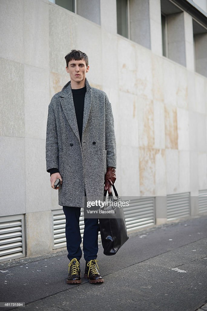 Thomas Gibbons poses wearing a Topman coat during day 2 of Milan Menswear Fashion Week Fall/Winter 2015/2016 on January 18, 2015 in Milan, Italy.