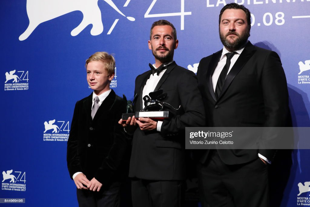 Thomas Gioria, Xavier Legrand and Denis Menochet pose with the Silver Lion for Best Director Award for 'Jusqu'à la Garde' and the 'Luigi De Laurentiis' Venice Award for a Debut Film for 'Jusqu'à la Garde' at the Award Winners photocall during the 74th Venice Film Festival at Sala Casino on September 9, 2017 in Venice, Italy.