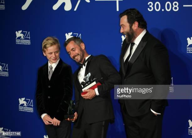 Thomas Gioria Xavier Legrand and Denis Menochet pose with the Silver Lion for Best Director Award for 'Jusqu' la Garde' and the 'Luigi De Laurentiis'...
