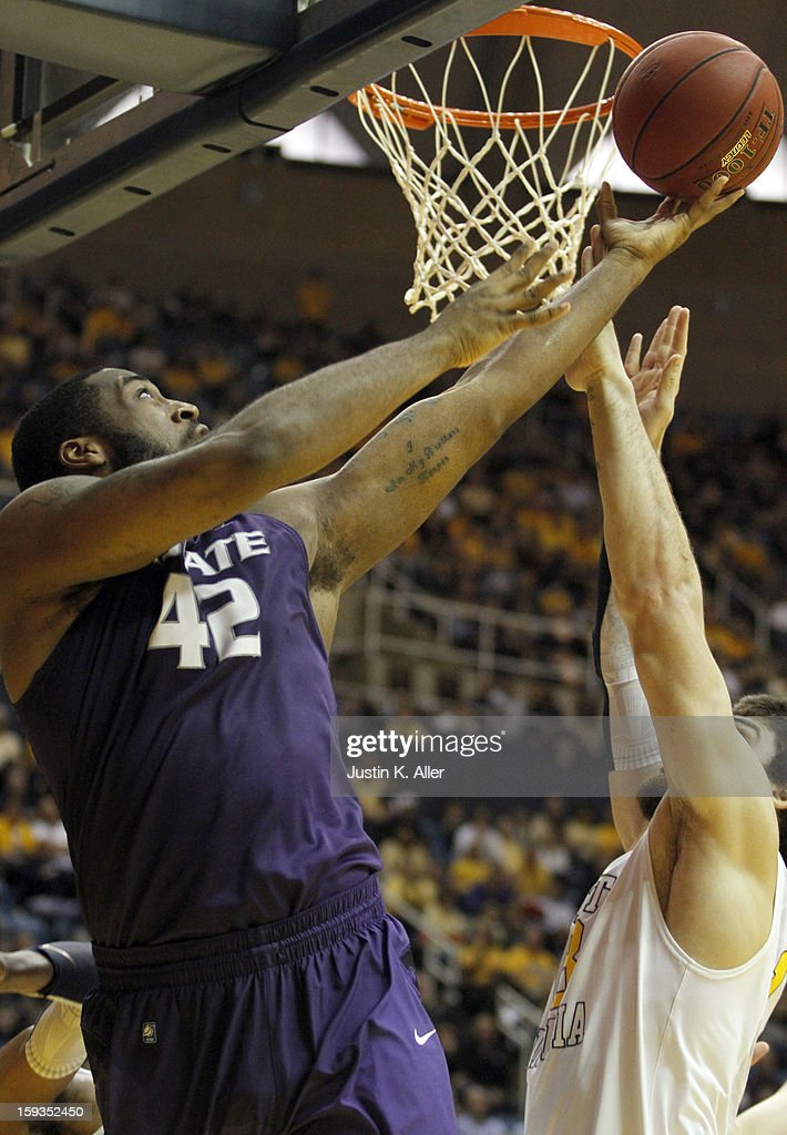 Thomas Gipson #42 of the Kansas State Wildcats attempts a layup against the West Virginia Mountaineers during the game at at the WVU Coliseum on January 12, 2013 in Morgantown, West Virginia.