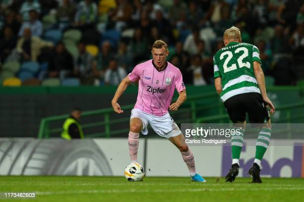 Thomas Goiginger of LASK tries to escape Jeremy Mathieu of Sporting CP during the UEFA Europa League group D match between Sporting CP and LASK at...