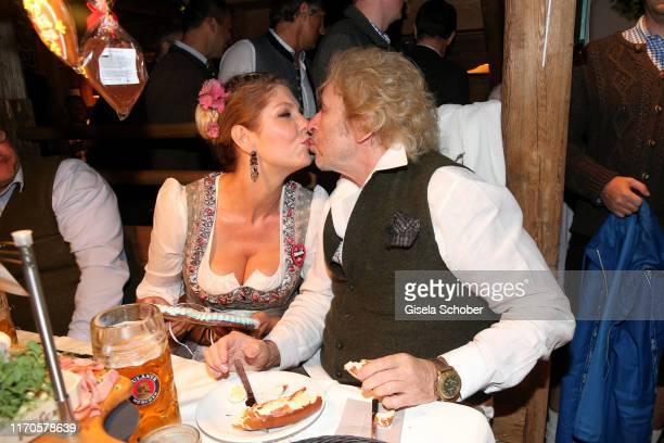 Thomas Gottschalk, Karina Mross during the Oktoberfest 2019 at Kaeferschaenke tent Theresienwiese on September 23, 2019 in Munich, Germany.