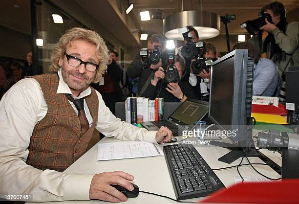 Thomas Gottschalk the German television host best known for hosting the program 'Wetten dass' checks messages from viewers sent online after the...