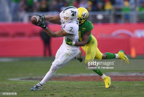 Thomas Graham Jr. #4 of the Oregon Ducks breaks up the pass to Cody White of the Michigan State Spartans on fourth down late in the fourth quarter of...