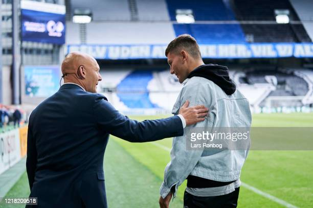 Thomas Gravesen, football expert of Discovery Eurosport talking to Jonas Wind of FC Copenhagen prior to the Danish 3F Superliga match between FC...