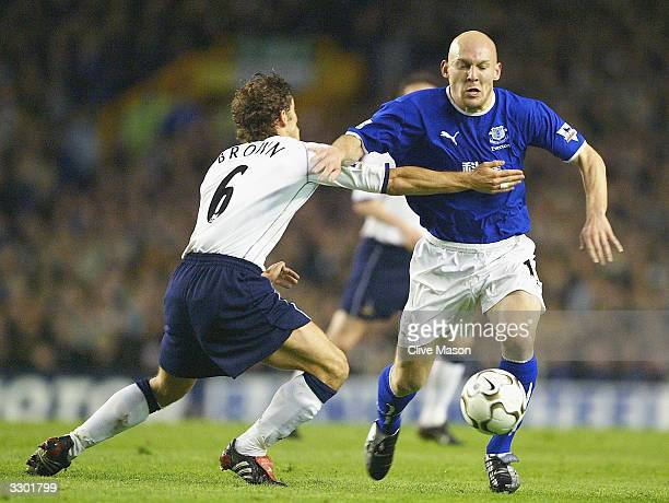 Thomas Gravesen of Everton is held back by Michael Brown of Tottenahm Hotspur during the FA Barclaycard Premiership match between Everton and...