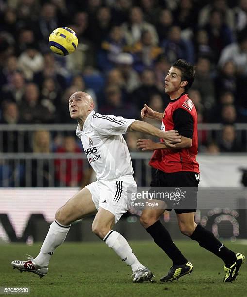 Thomas Gravesen of Real Madrid fends off Luis Garcia of Mallorca during the Primera Liga match between Real Madrid v Mallorca at the Bernabeu Stadium...