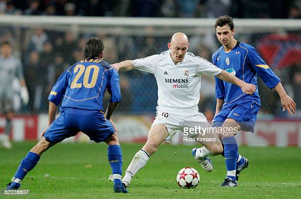 Thomas Gravesen of Real Madrid is challenged by Manuele Blasi of Juventus during the UEFA Champions League match between Real Madrid and Juventus at...