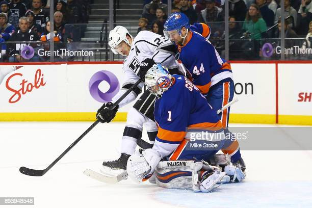 Thomas Greiss and Calvin de Haan of the New York Islanders defend the net against Dustin Brown of the Los Angeles Kings during the second period at...