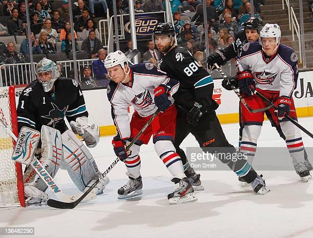 Thomas Greiss Brent Burns and Andrew Desjardins of the San Jose Sharks defend the net against Derek Dorsett and Samuel Pahlsson the Columbus Blue...