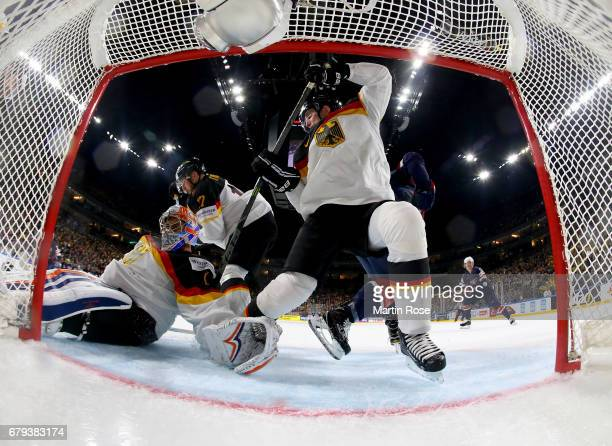 Thomas Greiss goaltender of Germany makes a save during the 2017 IIHF Ice Hockey World Championship game between USA and Germany at Lanxess Arena on...