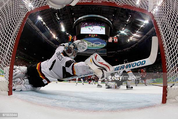 Thomas Greiss of Germany dives to make a save during the ice hockey Men's Qualification Playoff game between Germany and Canada on day 12 of the...