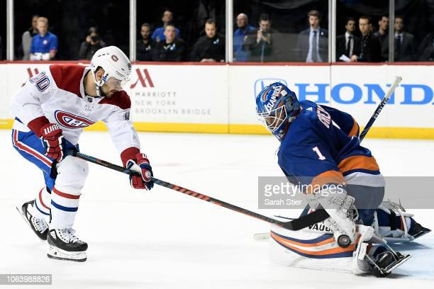 Thomas Greiss of the New York Islanders blocks a shot by Tomas Tatar of the Montreal Canadiens during a shootout in overtime at Barclays Center on...