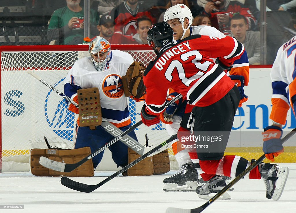Thomas Greiss #1 of the New York Islanders braces for a shot by Kyle Quincey #22 of the New Jersey Devils during the third period at the Prudential Center on October 5, 2016 in Newark, New Jersey. The Islanders defeated the Devils 3-2.