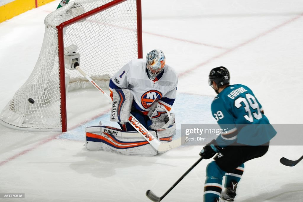 Thomas Greiss #1 of the New York Islanders deflects the puck as Logan Couture #39 of the San Jose Sharks looks at SAP Center on October 14, 2017 in San Jose, California.
