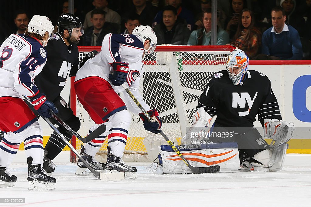 Thomas Greiss #1 of the New York Islanders make s a save against Boone Jenner #38 of the Columbus Blue Jackets at the Barclays Center on January 12, 2016 in Brooklyn borough of New York City. The Islanders defeated the Blue Jackets 5-2.