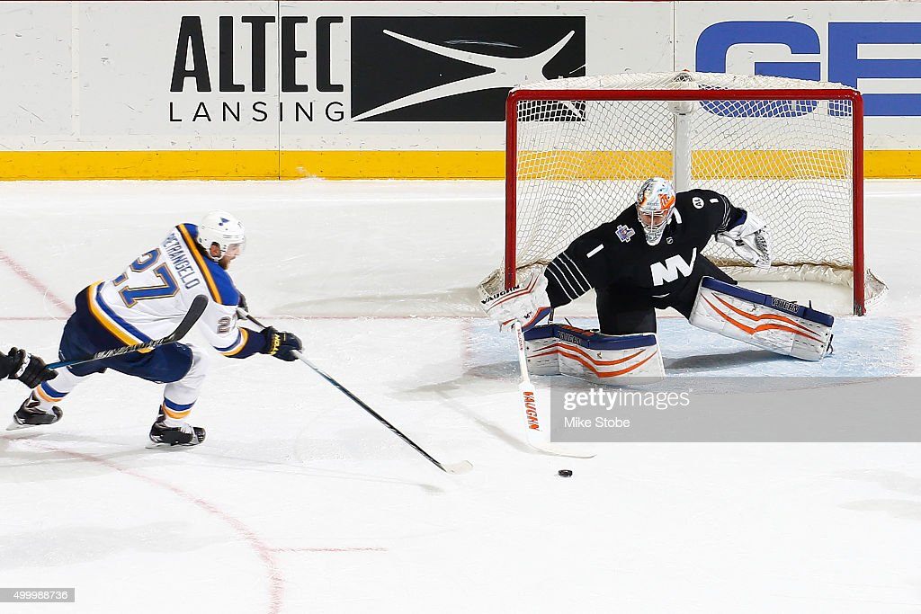 Thomas Greiss #1 of the New York Islanders makes a stick save against Alex Pietrangelo #27 of the St. Louis Blues at the Barclays Center on December 4, 2015 in Brooklyn borough of New York City.