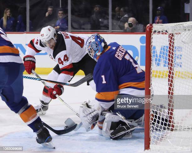 Thomas Greiss of the New York Islanders makes the first period save on Miles Wood of the New Jersey Devils at the Barclays Center on November 03 2018...