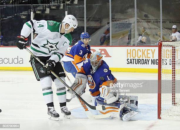 Thomas Greiss of the New York Islanders makes the first period save on Jamie Benn of the Dallas Stars at the Barclays Center on January 3 2016 in the...