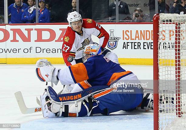 Thomas Greiss of the New York Islanders makes the first period save on Nick Bjugstad of the Florida Panthers in Game Four of the Eastern Conference...