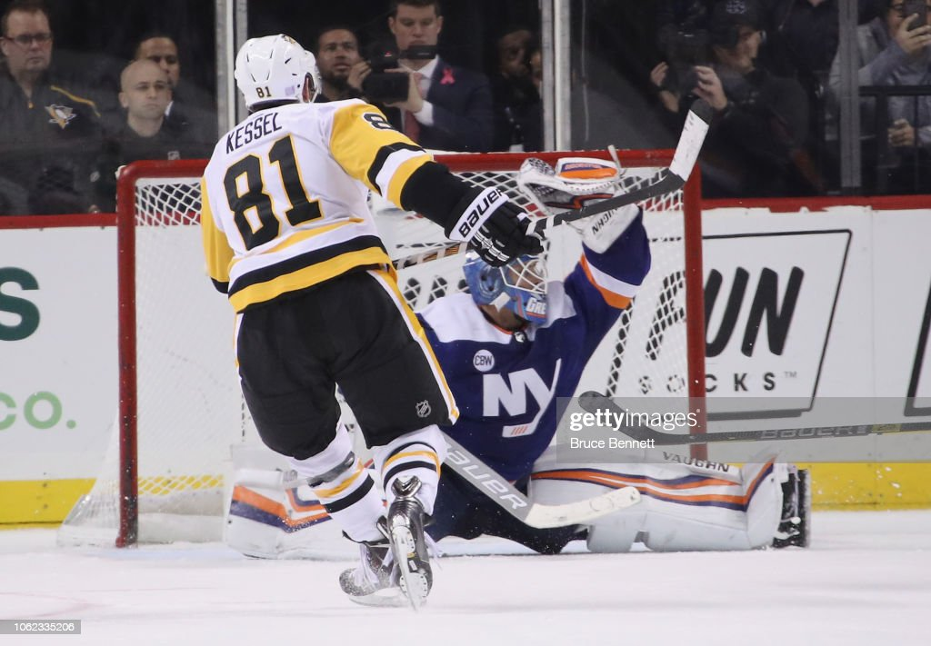 the latest 760b3 8bdb9 Thomas Greiss of the New York Islanders makes the save on ...
