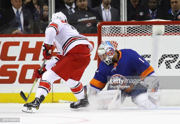 Thomas Greiss of the New York Islanders makes the second period save on Josh Jooris of the Carolina Hurricanes at the Barclays Center on November 16...