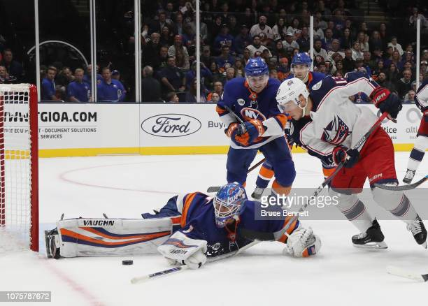 Thomas Greiss of the New York Islanders makes the third period save on Cam Atkinson of the Columbus Blue Jackets at the Nassau Veterans Memorial...