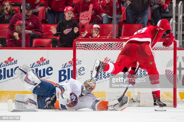 Thomas Greiss of the New York Islanders stops Anthony Mantha of the Detroit Red Wings on an OT breakaway during an NHL game at Little Caesars Arena...