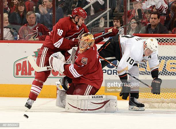 Thomas Greiss of the Phoenix Coyotes attempts to make a save as teammate Rostislav Klesla clears out Corey Perry of the Anaheim Ducks at Jobingcom...