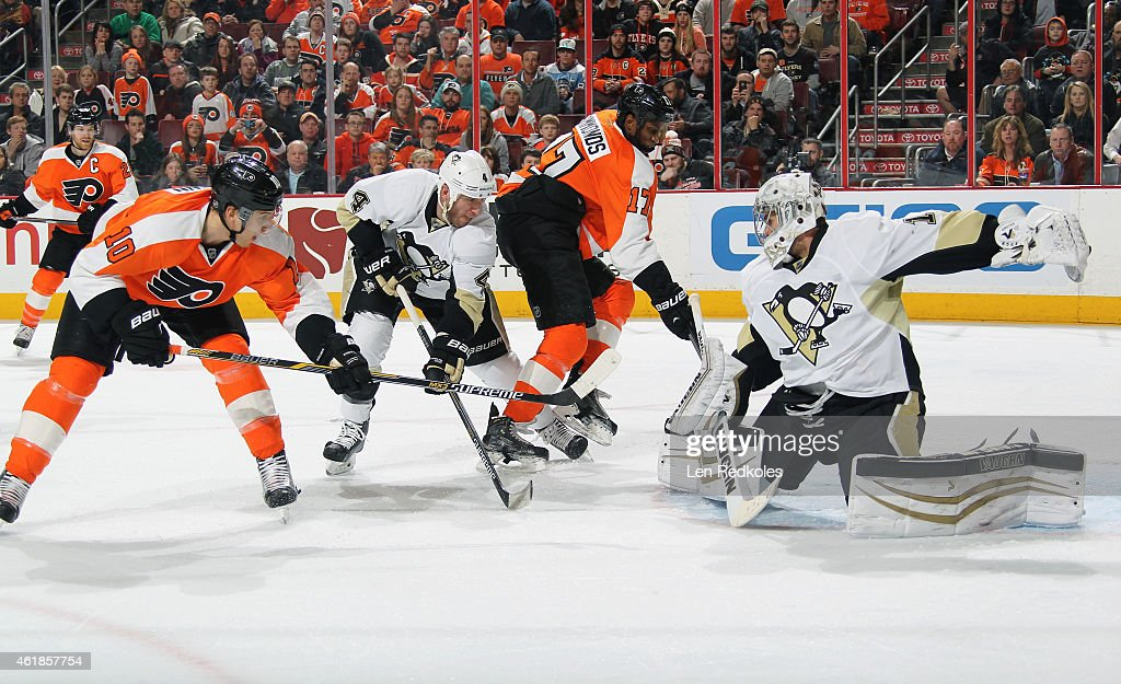 Thomas Greiss #1 of the Pittsburgh Penguins makes a kick save as teammate Rob Scuderi #4 defends against Brayden Schenn #10 and Wayne Simmonds #17 of the Philadelphia Flyers on January 20, 2015 at the Wells Fargo Center in Philadelphia, Pennsylvania. The Flyers went on to defeat the Penguins 3-2 in overtime.