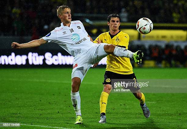 Thomas Grogaard of Odd is challenged by Jonas Hofmann of Borussia Dortmund the UEFA Europa League Play Off Round 2nd Leg match between Borussia...